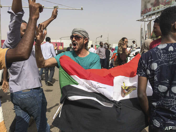 People celebrate the end of three decades of autocratic rule by President Omar al-Bashir, in Khartoum, Sudan, April 11, 2019.