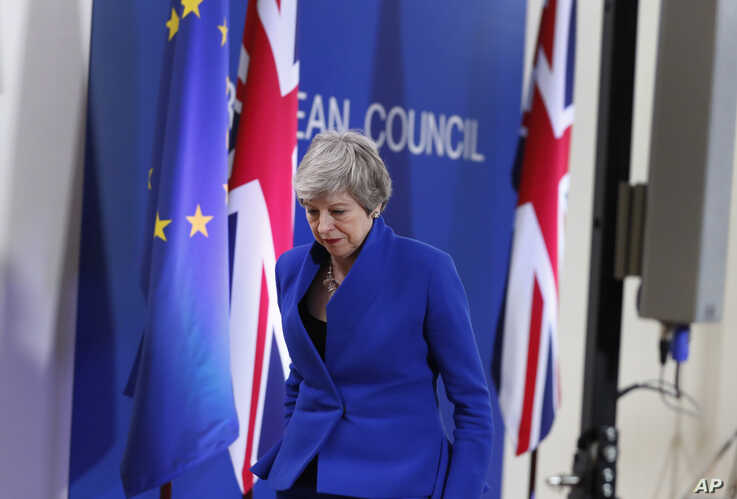 British Prime Minister Theresa May leaves the podium after addressing a media conference at the conclusion of an EU summit in Brussels, April 11, 2019.