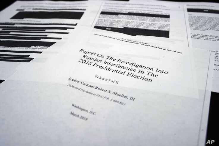 Four pages of special counsel Robert Mueller report on the witness table in the House Intelligence Committee hearing room on Capitol Hill, in Washington, April 18, 2019.