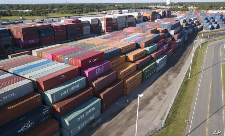 China Shipping Company and other containers are stacked at the Virginia International's terminal in Portsmouth, Va., May 10, 2019.