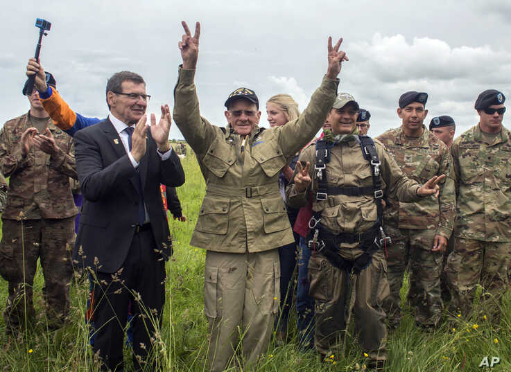 APTOPIX France D-Day Parachuting Over NormandyU.S. World War II D-Day veteran Tom Rice, from Coronado, California, flashes victory signs after parachuting in a tandem jump into a field in Carentan, Normandy, France, June 5, 2019.