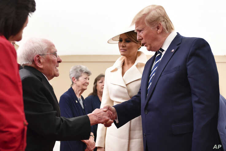 President Donald Trump shakes the hand of a World War II veteran during events marking D-Day's 75th Anniversary in Portsmouth, England, June 5, 2019.