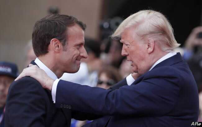 French President Emmanuel Macron, left, meets U.S President Donald Trump during a ceremony to mark the 75th anniversary of D-Day at the Normandy American Cemetery in Colleville-sur-Mer, Normandy, France, June 6, 2019.