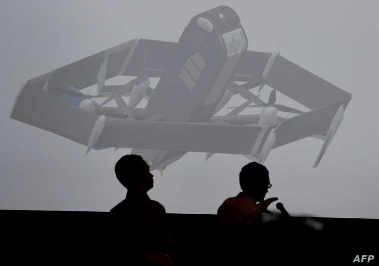 The new Amazon delivery drone is displayed on a screen during the Amazon Re:MARS conference on robotics and artificial intelligence in Las Vegas, Nevada, on June 5, 2019.