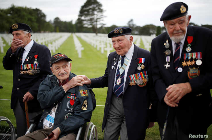 WWII D-Day veterans, including Richard Llewellyn and Mervyn Kersh from Britain and Norman Duncan from the U.S., attend a ceremony at Normandy American Cemetery and Memorial situated above Omaha Beach, France.