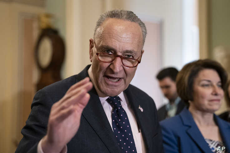 Senate Minority Leader Chuck Schumer, D-N.Y.,  joined at right by Sen. Amy Klobuchar, D-Minn., speaks to reporters at the Capitol in Washington,  April 9, 2019.
