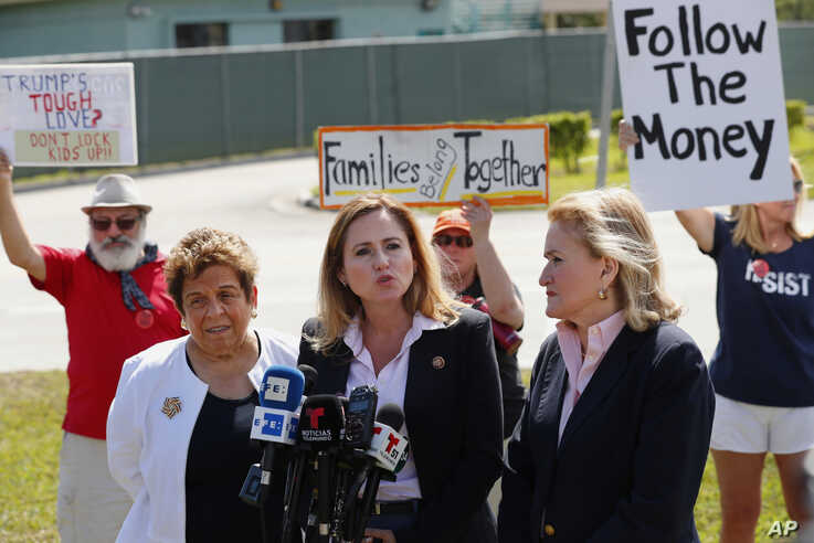 Rep. Debbie Mucarsel-Powell, D-Fla., center, speaks to members of the media about her tour of the Homestead Temporary Shelter for Unaccompanied Children, as Rep. Donna Shalala, D-Fla., left, and Rep. Sylvia Garcia, D-Texas, right, look on, Feb. 19, 2019, in Homestead, Fla.