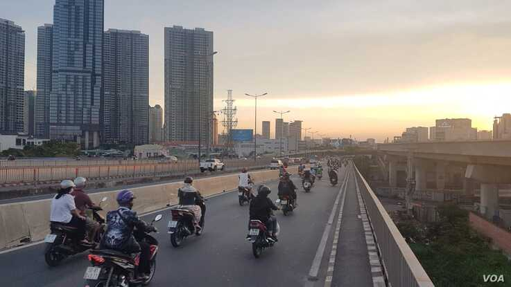 Vietnam is the fourth biggest market in the world for motorbikes, which millions of drivers like these in Ho Chi Minh City rely on daily.