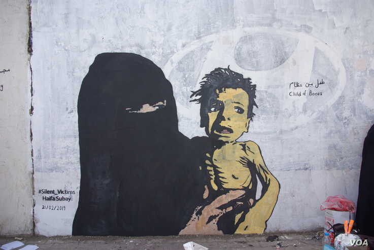 """A mural named """"A Boy of Bones,"""" painted by Yemeni artist Haifa Subay. The mural seeks to warn about the risk of famine, which is threatening the lives of millions of children in Yemen."""