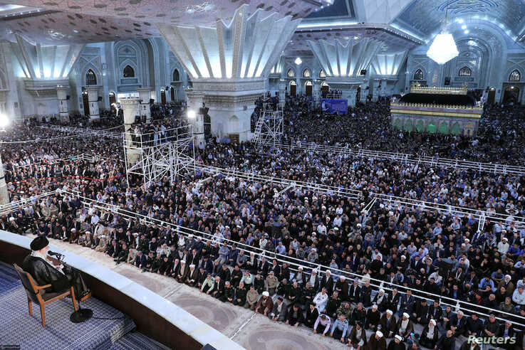 People listen to Iran's Supreme Leader Ayatollah Ali Khamenei as he speaks at a ceremony marking the 30th death anniversary of the founder of the Islamic Republic Ayatollah Ruhollah Khomeini in Tehran, Iran June 4, 2019.