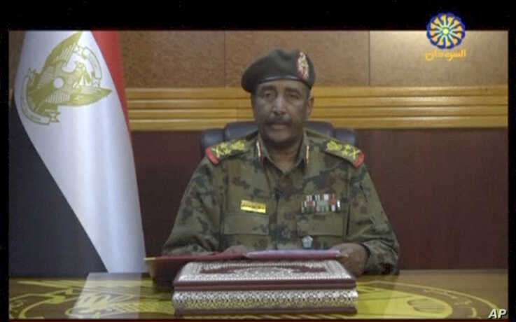 Image from video provided by Sudan TV, shows Lieutenant General Abdel-Fattah Burhan, head of the Sudanese Transitional Military Council, TMC, making a broadcast announcement in Khartoum, Sudan, June 4, 2019.