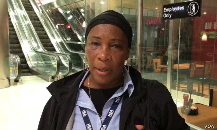 Marie Eveline shared her excitement about the Haitian national team win at the Miami International airport. (J. Belizaire / VOA Creole)