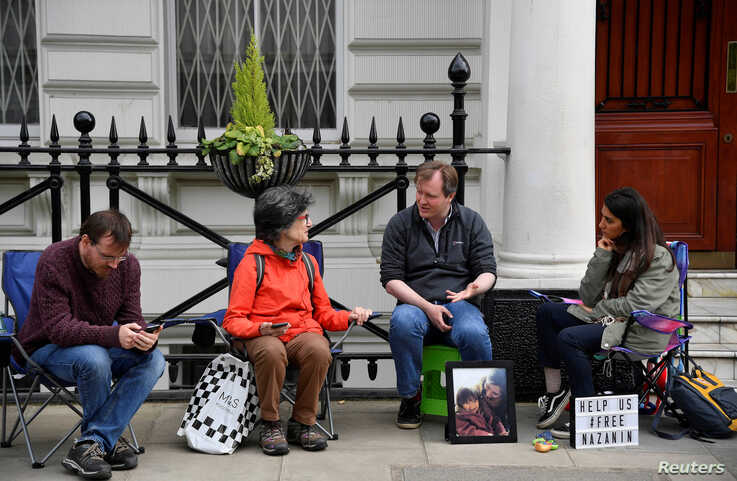 Richard Ratcliffe, the husband of jailed British-Iranian aid worker Nazanin Zaghari-Ratcliffe speaks with supporters as he stages a vigil and goes on hunger strike outside of the Iranian embassy in London, Britain, June 15, 2019.