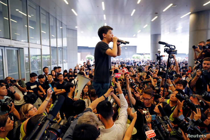 Pro-democracy activist Joshua Wong addresses the crowds outside the Legislative Council during a demonstration demanding Hong Kong's leaders to step down and withdraw the extradition bill, in Hong Kong, China, June 17, 2019.