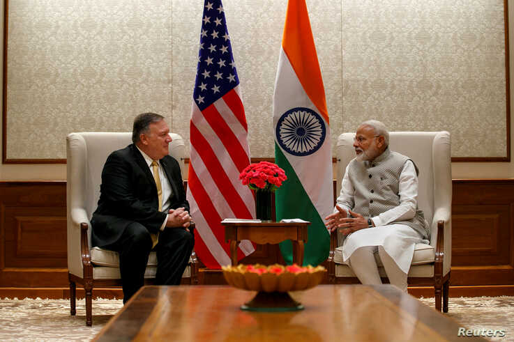 U.S. Secretary of State Mike Pompeo (L), talks with Indian Prime Minister Narendra Modi during their meeting at the Prime Minister's Residence, June 26, 2019, in New Delhi, India.