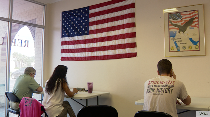 Volunteers making calls for the Trump-Pence 2020 Campaign, in Seminole County, a suburb of Orlando, FL. (VOA video grab)