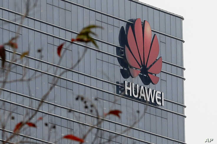 A logo of Huawei marks one of the company's buildings in Dongguan, in China's Guangdong province, March 6, 2019.