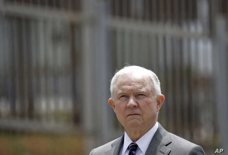 FILE - Attorney General Jeff Sessions is shown during a news conference in San Diego near the border with Tijuana, Mexico, May 7, 2018.
