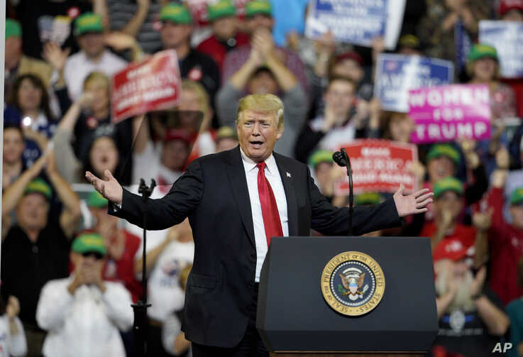 President Donald Trump speaks during a Make America Great Again rally at the Mid-America Center in Council Bluffs, Iowa, Tuesday, Oct. 9, 2018. (AP Photo/Nati Harnik)