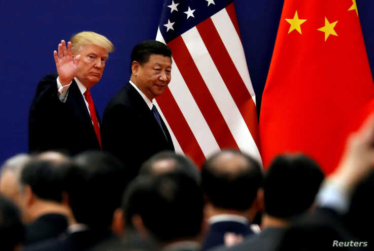 U.S. President Donald Trump and China's President Xi Jinping meet business leaders at the Great Hall of the People in Beijing, China, Nov. 9, 2017.