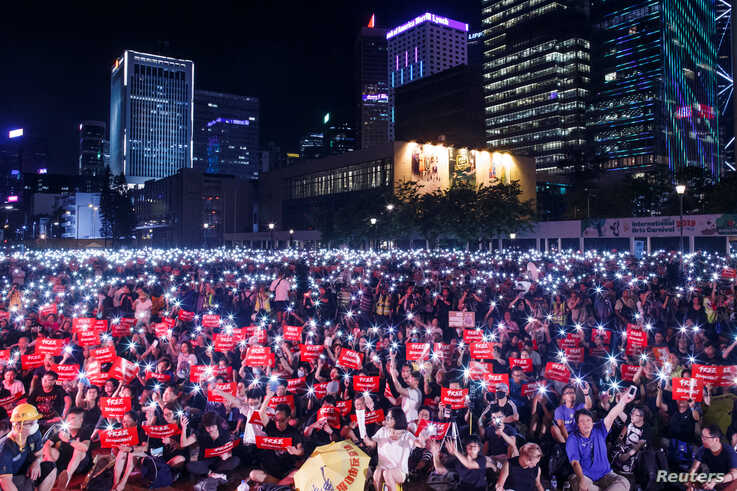 Demonstrators rally ahead of the G20 summit, urging the international community to back their demands for the government to withdraw the extradition bill in Hong Kong, China.