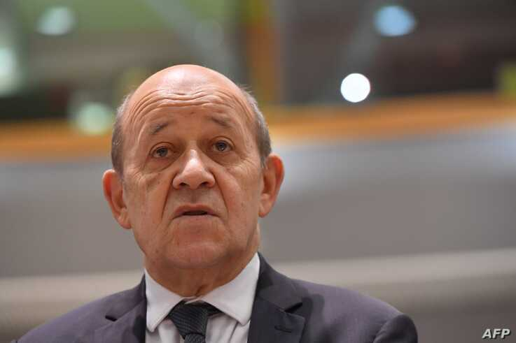 French Foreign Affairs Minister Jean-Yves Le Drian looks on during a Foreign Affairs meeting at the EU headquarters in Brussels, July 15, 2019.