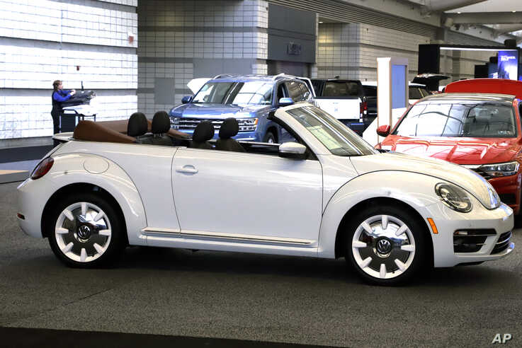FILE - A 2019 Volkswagen Beetle convertible is on display at the 2019 Pittsburgh International Auto Show in Pittsburgh, Feb. 14, 2019.