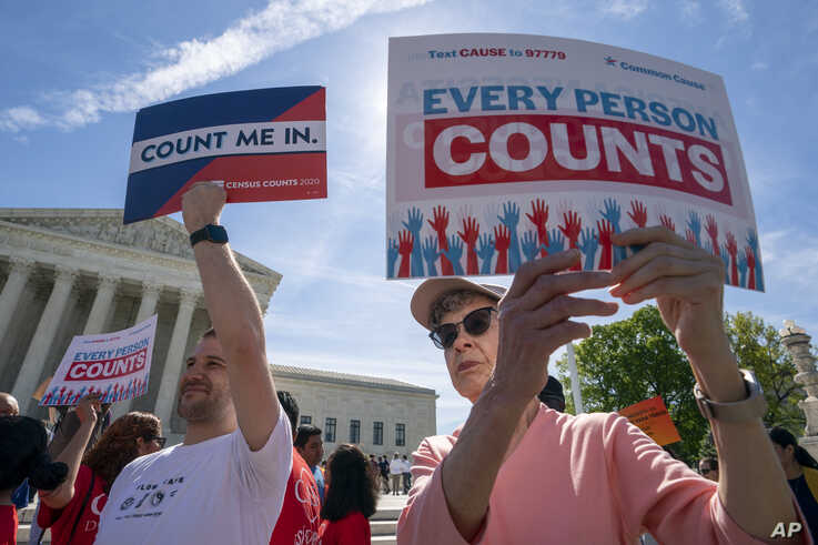 Immigration activists rally outside the Supreme Court as the justices hear arguments over the Trump administration's plan to ask about citizenship on the 2020 census, in Washington, April 23, 2019.