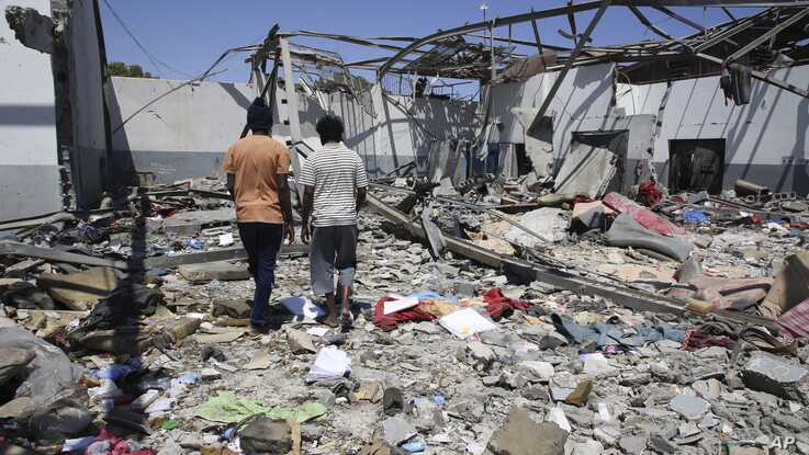 Debris covers the ground after an airstrike at a detention center in Tajoura, east of Tripoli in Libya, Wednesday, July 3, 2019.