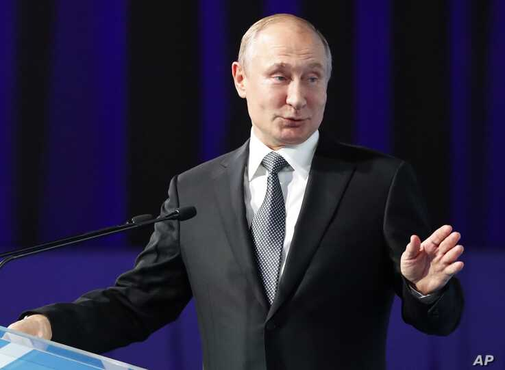 """Russian President Vladimir Putin gestures as he delivers his speech during the International Forum """"The development of parliamentarism"""" in Moscow, Russia, July 3, 2019."""