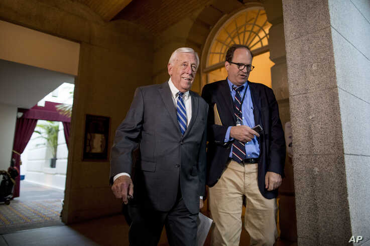 House Majority Leader Steny Hoyer of Md.(L) arrives for a House Democratic caucus meeting on Capitol Hill in Washington, July 10, 2019.