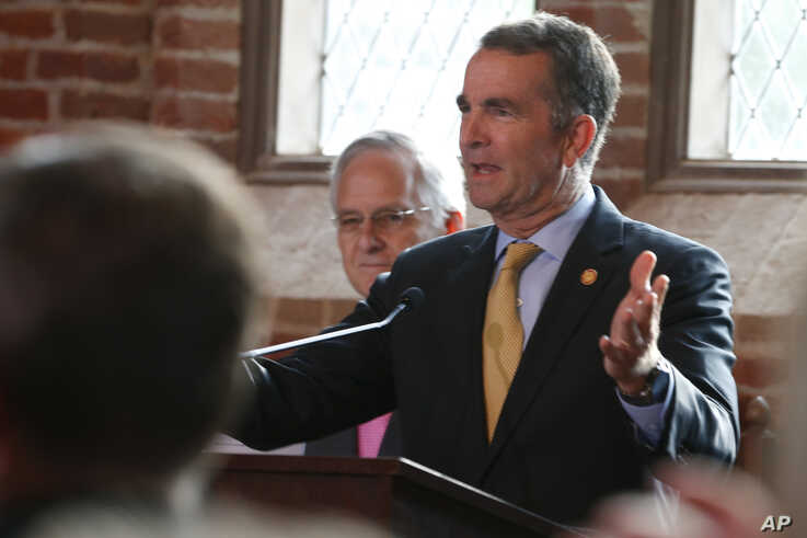 Virginia Gov. Ralph Northam addresses a commemorative meeting of the Virginia General Assembly on the 400th anniversary of the first House of Burgess meeting at a church in Historic Jamestown, Va., on the site where the meeting took place, July 30, 2019.