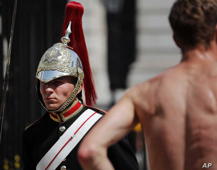 A member of the Queen's Lifeguard marches at Horse guards Parade as temperatures rose far above 30 Celsius (86F) in London,  July 25, 2019.
