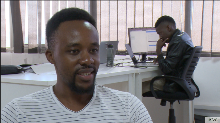 Dennis Kadengu buys cryptocurrency when he can, fearing Zimbabwe's currency will continue losing value against major currency, in Harare, July 16, 2019. (Columbus Mavhunga/VOA)