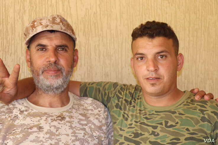 Mohammed Galaw, a commander with the western Tripoli forces, left, with Ali Fateeh Elfegi, right, hours before Ali died on July 7, 2019. (H.Murdock/VOA)