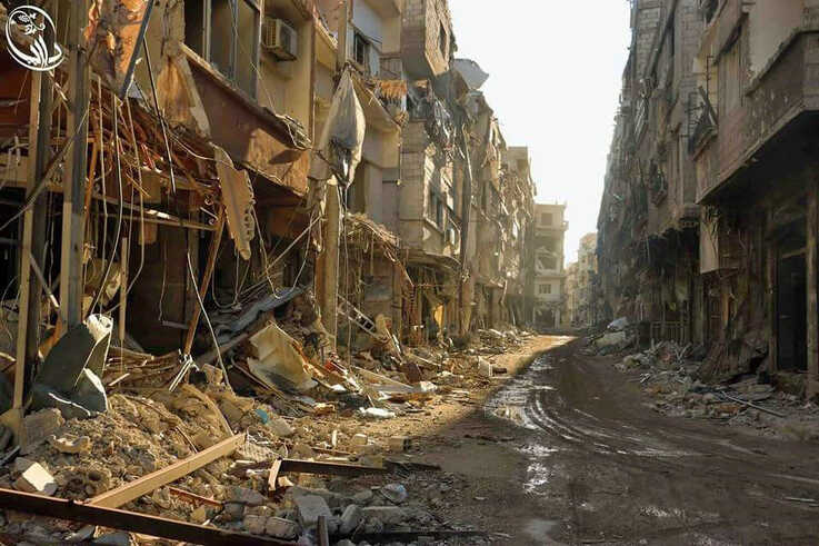 Damaged buildings line the street in Daraya after bombardment by the Syrian regime.