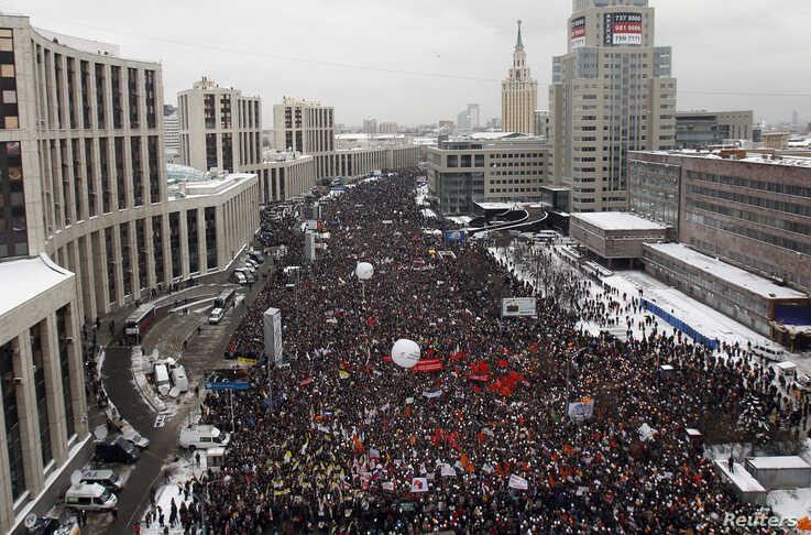 FILE - Demonstrators gather to protest recent parliamentary election results in Moscow, Dec. 24, 2011.