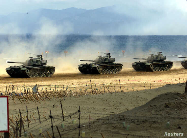 FILE - Taiwan Army U.S.-made M-48 tanks take part in a live fire exercise on the southern Pingtung sea front, April 20, 2001.