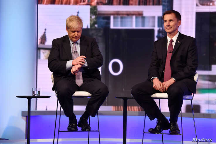 FILE - Boris Johnson and Jeremy Hunt appear on BBC TV's debate with candidates vying to replace British PM Theresa May, in London, Britain, June 18, 2019.