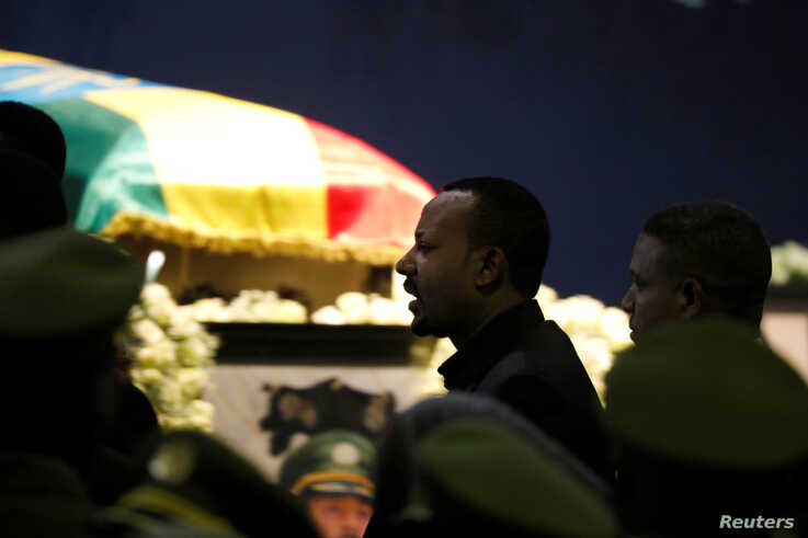 Ethiopia's Prime Minister Abiy Ahmed walks past the coffin of Army Chief of Staff Seare Mekonnen, who was shot by his bodyguard, during a memorial ceremony in Addis Ababa, Ethiopia June 25, 2019.