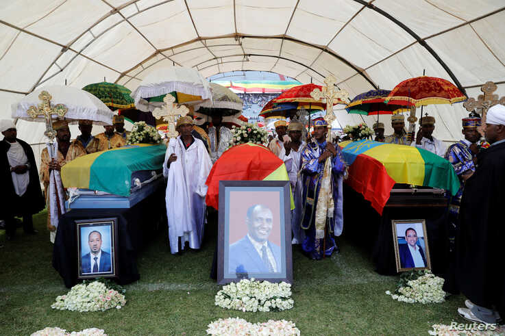 The coffins of Amhara president Ambachew Mekonnen and two other officials who where killed in an attack are seen during a funeral ceremony in the town of Bahir Dar, Amhara region, Ethiopia June 26, 2019.