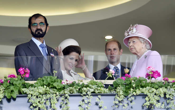FILE - Sheikh Mohammed bin Rashid al-Maktoum, from left, Princess Haya bint al-Hussein, Britain's Prince Edward and Queen Elizabeth attend Britain's Royal Ascot horse races, June 15, 2016.