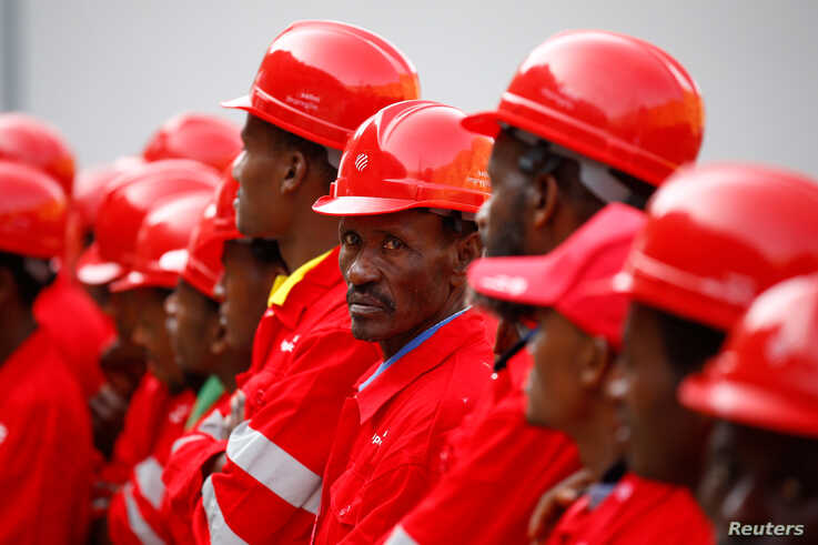 FILE - Workers stand at the Gibe III hydroelectric dam during its inauguration in Shoma Yero village in Southern Nations, Nationalities, and Peoples' Region in Ethiopia, Dec. 17, 2016.