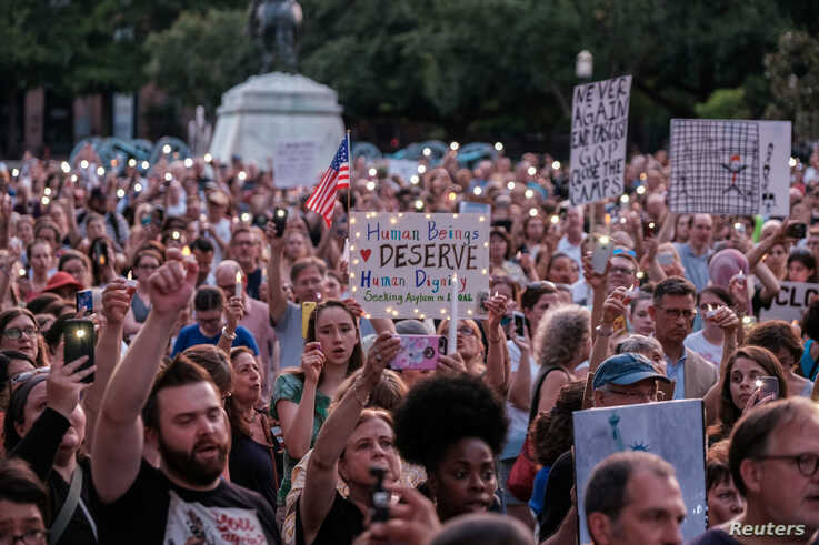 """Immigration rights activists hold a """"Lights for Liberty"""" rally and candle light vigil in front of the White House in Washington,  July 12, 2019."""