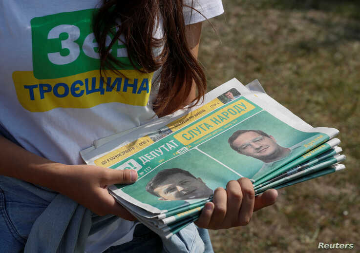 A volunteer holds electoral materials in support of the Servant of the People party led by Ukrainian President Volodymyr Zelenskiy during an event ahead of the parliamentary election in Kiev, Ukraine, July 18, 2019.