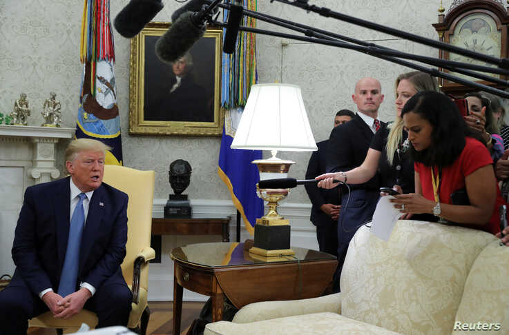 U.S. President Donald Trump speaks while meeting with Pakistan's Prime Minister Imran Khan in the Oval Office at the White House in Washington, July 22, 2019.