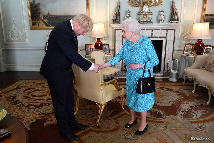 Queen Elizabeth II welcomes Boris Johnson during an audience in Buckingham Palace, before officially recognizing him as the new Prime Minister, in London, Britain, July 24, 2019.