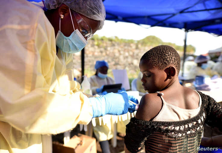 FILE - A Congolese health worker administers Ebola vaccine to a child at the Himbi Health Centre in Goma, Democratic Republic of Congo, July 17, 2019.
