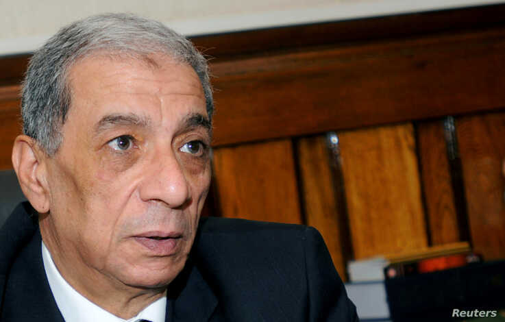 FILE - Egyptian public prosecutor Hisham Barakat is seen in his office in Cairo, Egypt, July 10, 2013.