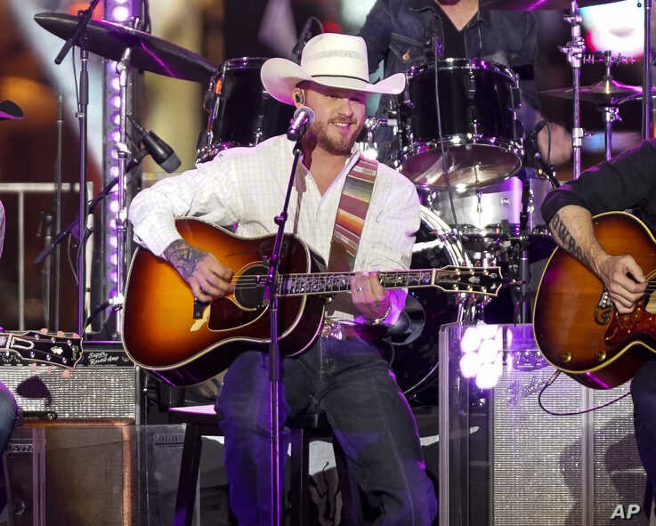 """FILE - Country singer Cody Johnson performs during the CMT Crossroads """"Brooks & Dunn and Friends"""" live taping in Nashville, Tennessee, June 4, 2019."""